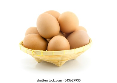 Eggs on basket isolated on white background.
