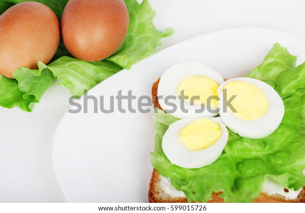 eggs on a plate with lettuce