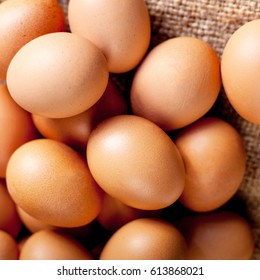 Eggs on wooden  background close up may use as wallpaper, poster, ad
