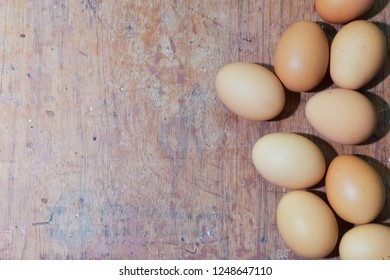 Eggs on wooden floor and space