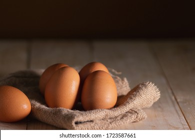 Eggs on wooden planks, various raw materials for cooking