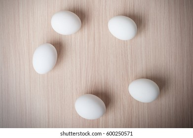Eggs on the wooden table