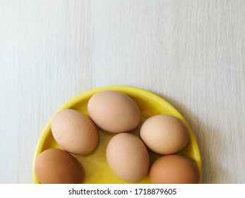 Eggs on a yellow plate