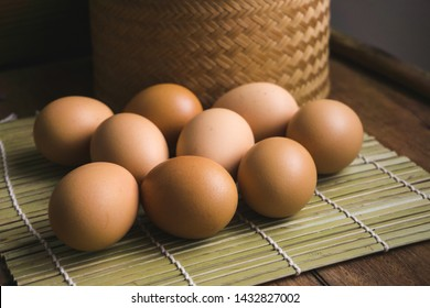eggs picture on brown wooden and bamboo basket background.