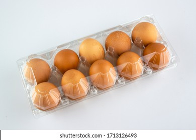 eggs in plastic packaging on a white background