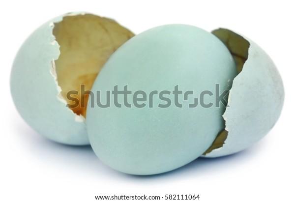 Eggs of pond heron over white background