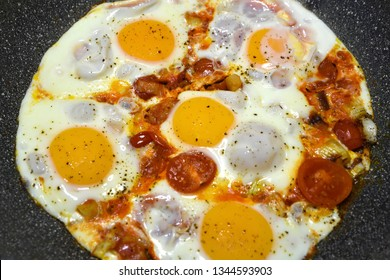 """""""Eggs in Purgatory"""", a traditional Mediterranean dish of Italian cuisine for breakfast with poached eggs on a spicy tomato sauce."""