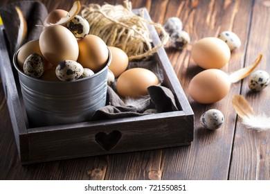 Eggs quail chicken wooden background