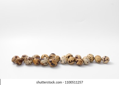 eggs quail spotted small on white background