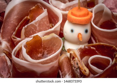 Egg's snowman surrounded by ham