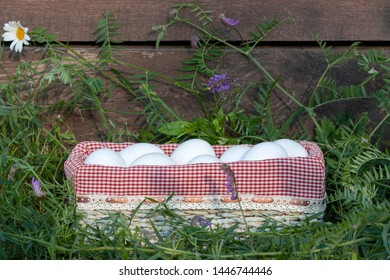 Eggs stacked in one basket on a rustic background