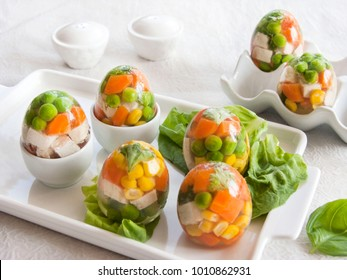 Eggs stuffed with aspic. Eggs easter. Chicken and vegetables in aspic for easter. Eggs dish. Food and drink.