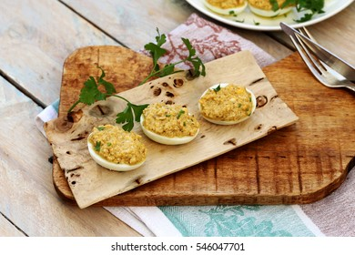 Eggs stuffed with liver pate with nuts, cheese, garlic.