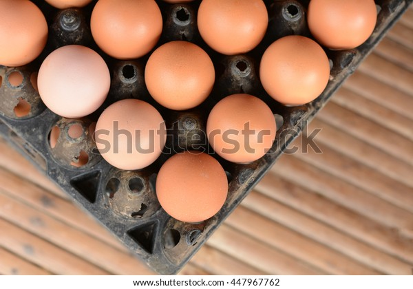 Eggs in tray on wooden table