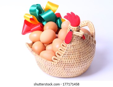 Eggs in weave chicken basketry isolated on white background.