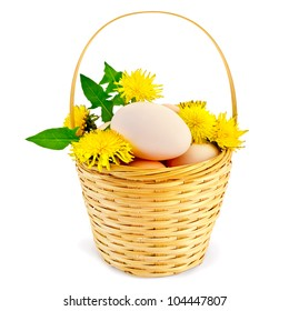 Eggs in a wicker basket with flowers and leaves of the dandelion is isolated on a white background