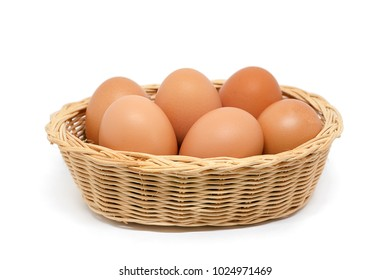 Eggs in the wicker basket on white background for healthy food concept