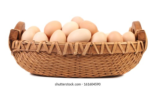 Eggs in the wicker brown basket. Isolated on a white background
