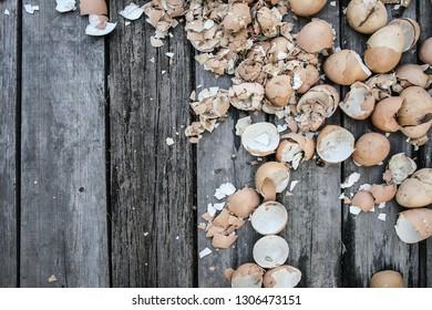 Eggshells on wooden table, Selective focus.background for design