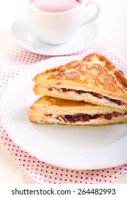 Eggy bread or French toast with cheese and jam filling