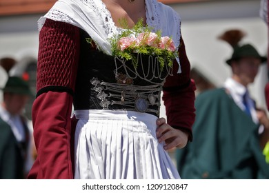 Egling, Germany - July 16: pageant with typical bavarian costumes at the gaufest in the historic town on july 16, 2018 in Egling, Bavaria, Germany