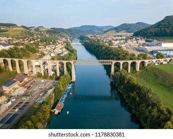 Eglisau, Switzerland August 28 2018 - Aerial image of the Railway bridge over the Rhine river at Swiss town Eglisau, Canton Zurich, which is built in 1845.
