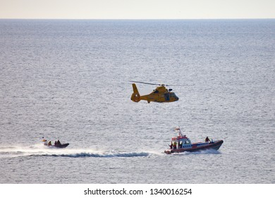Egmond aan Zee, Netherlands - July 18, 2017: members of the Dutch coastguard on boats and in a helicopter during a rescue drill on the North Sea