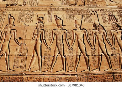 Egypt. Ancient egyptian temple. Detail of hieroglyphic inscription with Pharaoh, Goddess Hathor and God Horus