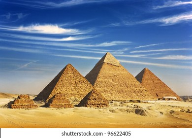 Egypt. Cairo - Giza. General view of pyramids from the Giza Plateau (three pyramids known as Queens' Pyramids on front side; next in order from left: the Pyramid of Menkaure, Khafre and Chufu