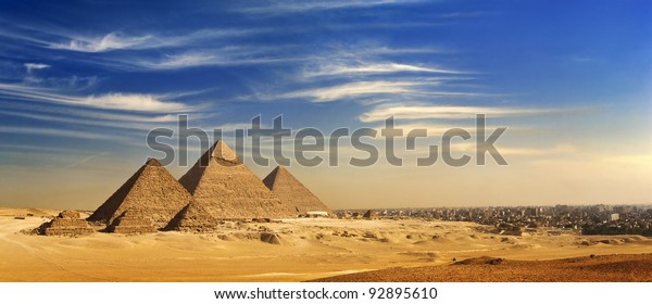Egypt. Cairo - Giza. General view of pyramids and cityskape from the Giza Plateau (on front side: three pyramids known as Queens' Pyramids; next: the Pyramid of Menkaure, Khafre and Chufu)