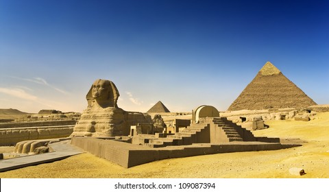 Egypt. Cairo - Giza. The Sphinx, the Pyramid of Khafre (Chephren) and Menkaure (Mykerinos) in background. The Pyramid Fields from Giza to Dahshur is on UNESCO World Heritage List