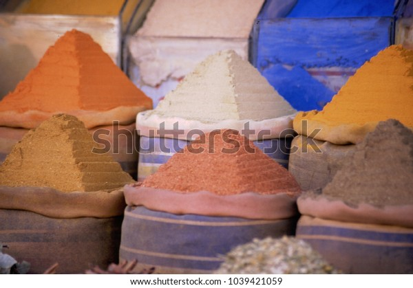 Egypt, colored spices form stepped pyramids at the Aswan market