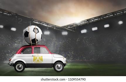 Egypt flag on car delivering soccer or football ball at stadium