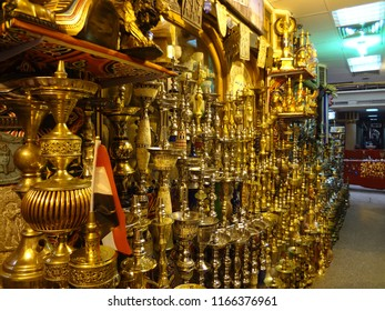 Egypt gold store front with hundreds of hooka water vapor smoking items.