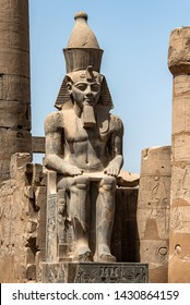 Egypt Luxor Temple. granite Statue of Ramesses II seated in front of columns