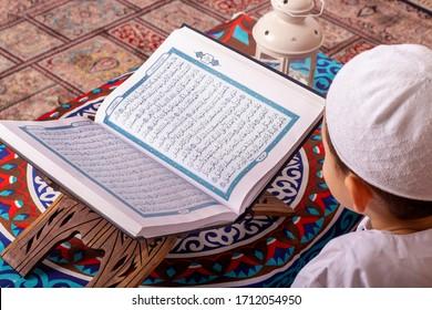Egypt - May 18 , 2019 - Muslim Young boy Reading Quran (Holy Muslims Book) in Ramadan