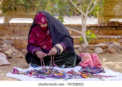 Egypt, Nuweiba - January 1,2017:A Bedouin woman selling her handmade accessories