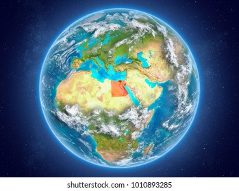 Egypt in red on model of planet Earth with clouds and atmosphere in space. 3D illustration. Elements of this image furnished by NASA.
