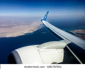 Egypt region, April 11,  2018: Boeing 737-500 of Ukraine Iternational airlines (UIA), above the red sea, preparing to  -  landi at Sharm el Sheih airport