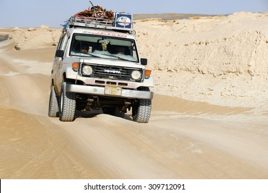 EGYPT, SAHARA - DEC 26, 2008: Off-road car shown in the Tent valley desert. Extreme desert safari is one of the main local tourist attraction in Egypt