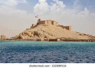 Egypt, Taba, 14-08-2018 years, Saladin castle, view from the sea, a fortress with towers and flag