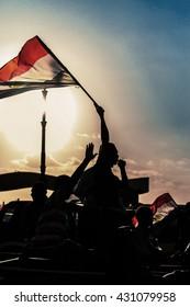 Egyptian Activist with Egyptian Flag Against Sunset - Alexandria, Sidi Gaber, Egypt 30 June 2013