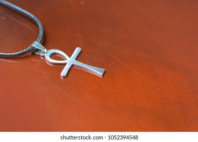 Egyptian amulet ankh on a red background,  Egyptian cross