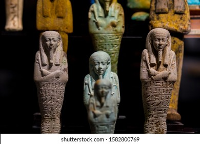 Egyptian Ancient Ushabtis made of with wood or faience. Selective focus. Ifergan Collection