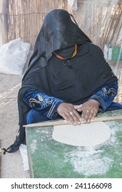 Egyptian bedouin woman making traditional bread in the desert