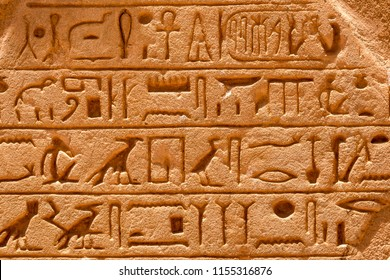 Egyptian carving figures and hieroglyphs on the walls of Abu Simbel temple in Aswan, Egypt, Africa