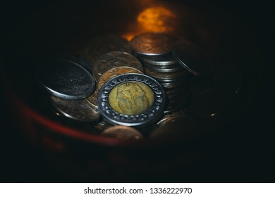 Egyptian coin with the image of Pharaoh is in the bowl among the coins of Russia, it can symbolize the relationship between the Egyptians and Russians, the right photo for business and commodity-money