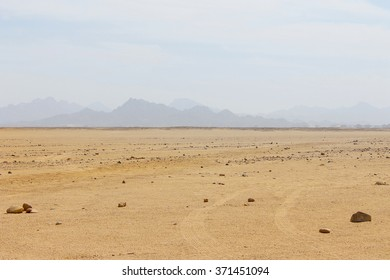 Egyptian Desert, Sand And Sky, Mountains In Background