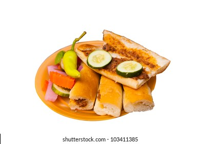 An Egyptian fast street food sandwich called a sogo filled with sausage on small pieces of bread.  Isolated on white background