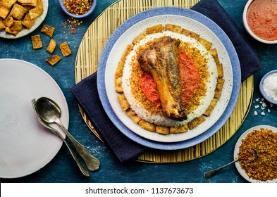 Egyptian Fattah with white rice and crispy bread topped with seasoned garlic red sauce,crispy fried garlic and roasted lamb shank.The traditonal meal of the Muslim religious festival Eid Al-Adha.